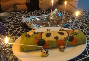 Panda green tea roll cake with candle
